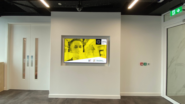 Digital signage in reception areas letting visitors know how the business is responding to COVID-19 guidelines.